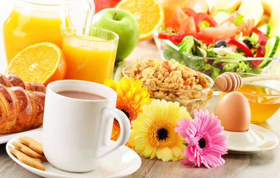 Breakfast with coffee, juice, croissant, salad, muesli and egg. Swedish buffet